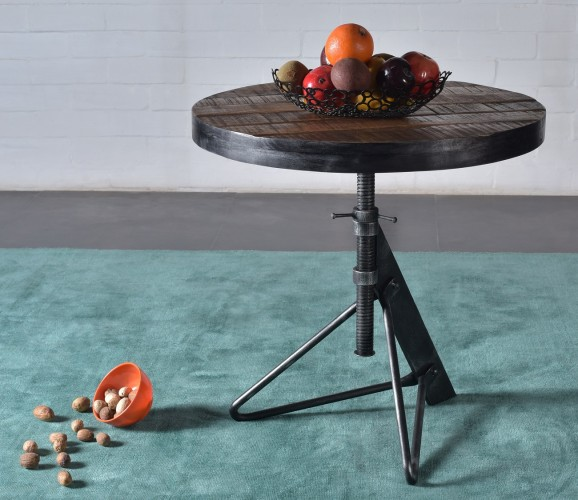 This industrial casual table features a solid mango top