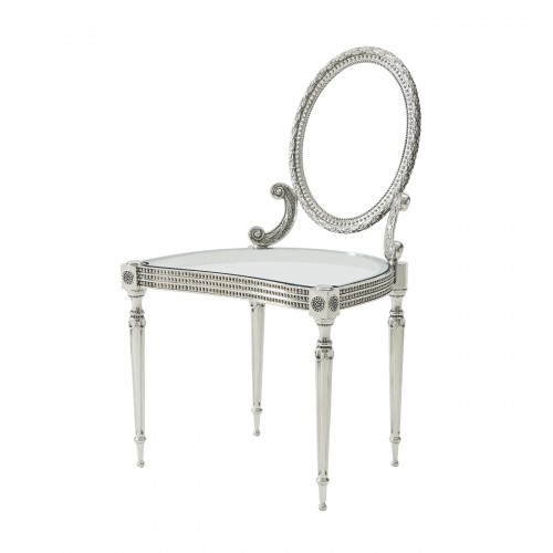 side chair in solid stainless steel the pierced oval wreath cast back above a glass inset seat