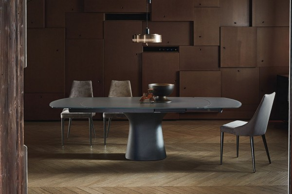 elliptic fixed table with base and top in concrete